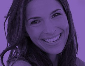 Young woman with gorgeous smile highlighted purple