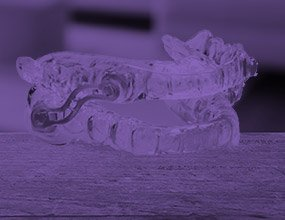 Sleep apnea oral appliance highlighted purple