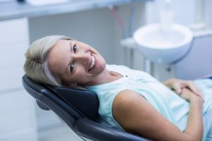 Smiling woman in the dental chair.