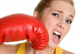 woman getting punched with boxing glove